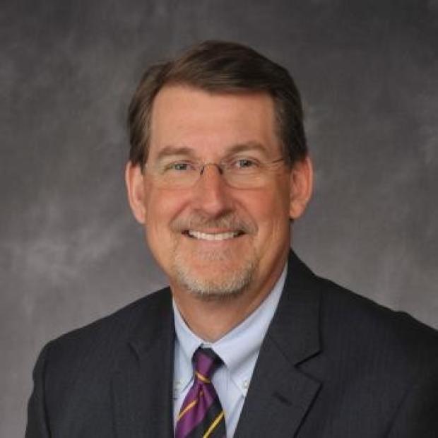 Dr. Dennis Lund